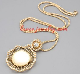 Glamorous Glided Golden necklace with cat's eye and rhinestones adorned pendants